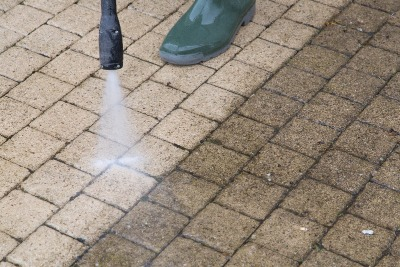 Power washing a stone patio.